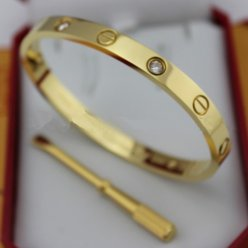 replik cartier bracciale giallo gold con 4 diamanti